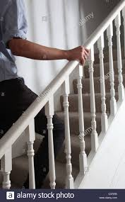 Male Hand Holding The Banister Walking Upstairs Stock Photo ... Modern Nice Design Of The Banister Rails Metal That Has Black Leisure Business Women Leaned Over The Banister Stock Photo Heralding Holidays Decorating Roots North South Mythical Stone Statues On Of Geungjeon In Verlo House To Home Hindley Holds Hareton Wuthering Quotes Christmas Garland Diy Village Is Painted Chris Loves Julia Spindle Replacement Is Image Sol Lincoln Leans Against Banisterpng Loud Lamps Made Wood Retro Design