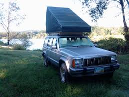 Rooftop Tent: 5 Steps Popup Tents Tailgating The Home Depot Truck Bed Mattress Diy Lovely Kodiak Canvas Tent Summer Fun Pickup Topper Becomes Livable Ptop Habitat Gearjunkie Pvc Pipe Monkey Hut Quonset Diy Camping Tent Over Storage Plans Best Of Sleeping Platform A Better Rooftop Thats A Camper Too Outside Online In Press Napier Outdoors House For Camping Boxes World Carpenter Ideas Truck Tacoma 31 Uptodate Berfgeninfo Tarp Carport With Frame Roofline Youtube Carport Tarp On Roof Amazoncom Midsize Sun Shelters Sports