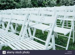 Chairs Set Up By The Green Lawn In Preparation For A Wedding ... Amazoncom Balsacircle 10 Pcs Rose Quartz Pink Spandex Stretchable Chairs Set By Green Lawn Preparation Stock Photo Edit Now White Folding Wedding Reception The Best Picture In Ideas Pretty Unique Seating Inside Weddings 16 Easy Chair Decoration Twis Youtube Reception Tables With Tall Upright Nterpieces And Wooden Ipirations Encore Events Rentals Outdoor Waterfront Round Linen Tables Supplies 20x Stretched Cover Sparkles Make It Special Black Ivory Arched Beautifully Decorated For Outdoors