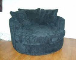 Swivel Cuddle Chairs Uk by Ashley Jumbo Cord Fabric Snug Swivel Cuddle Chair Black Amazon