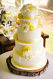 Rustic Yellow Summer Wedding with mason jar wood daisy centerpieces & a sweet dessert