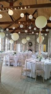 Giant Balloons Made The Perfect Centerpieces In This Room With White Washed Floors Exposed