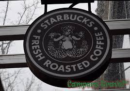 Original Starbucks Logo And Location In Seattle Washington