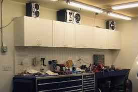 lights garage with corner cabinets and ceiling lighting for