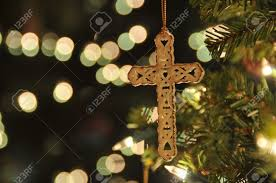 Cross Ornament On Christmas Tree With Bokeh Taken A Remote To Reduce Blur At