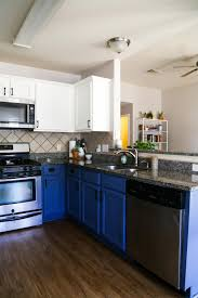 Kitchen With Blue And White Cabinets Mohawk Vinyl Plank Flooring On The Floor