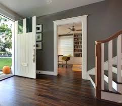 Gray Walls With Dark Wood Floors White Trim And Light