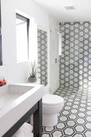 bathroom floor tiles continue into shower design ideas