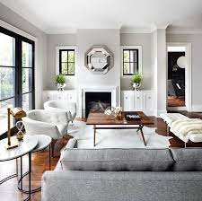 grey sofas and accent pillows on light grey living room