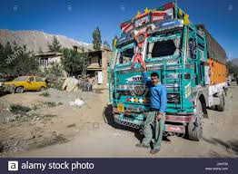 Indian Truck Driver Standing Beside His Well Loved And Colorful ...