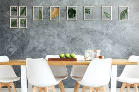 Gallery Of Framed Tropical Leaves Hanging On Gray Textured Wall..