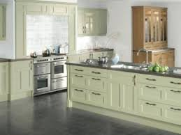 light green kitchen cabinets painted with white appliances