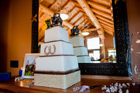 Photography By ENV Wedding Cake With Horseshoes On It