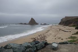 The View Of Martins Beach From Bottom Road Includes A Rock Formation