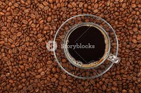 Full Americano Black Filtered Coffee In Transparent Glass Cup With Saucer On Background Of Roasted Beans Elevated Top View Close Up