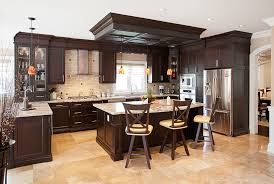 Kitchens With Dark Cabinets And Light Countertops by Giallo Ornamental Light Granite Kitchen With Cabinetry Dark Wood