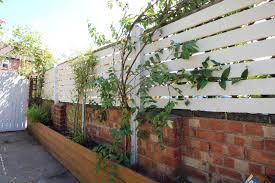 DIY Slat Fence Made From Pallets