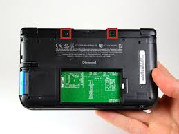 Using tweezers pull out the rubber bumpers that are located at the top of the device