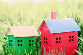 Paper Houses On Grass