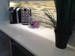 Quartz and glass tile backsplash go so well to her kitchens