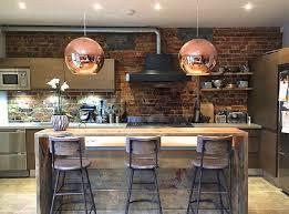 industrial bar stools globe copper pendant lights exposed brick
