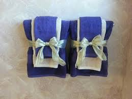 decorative bathroom towels in purple and gold theme decorating