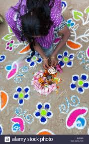 India Woman Making A Rangoli Design Outside Her Home In The ... Best Rangoli Design Youtube Loversiq Easy For Diwali Competion Ganesh Ji Theme 50 Designs For Festivals Easy And Simple Sanskbharti Rangoli Design Sanskar Bharti How To Make Free Hand Created By Latest Home Facebook Peacock Pretty Colorful Pinterest Flower 7 Designs 2017 Sbs Your Language How Acrylic Diy Kundan Beads Art Youtube Paper Quilling Decorating