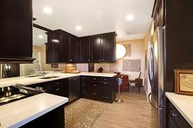 dark kitchen cabinets with light wood floors outofhome