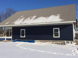 The Day After Siding Was Completed Snow Gone