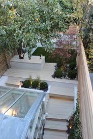 Runnen Floor Decking Uk by Small Garden With Artificial Lawn Millboard Decking Rendered