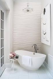 bathroom features an accent wall clad in wavy tiles