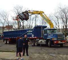 File:Demolition Lifting Burnt Car To Waste Removal Truck.JPG ...