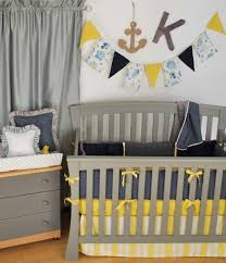 navy polka dot crib bedding with yellow for a nautical theme in