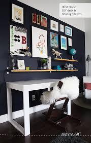 DIY shelves using IKEA Ekby Bjärnum brackets and a gallery wall