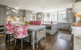 Gray And Pink KItchen With Two Islands Lit By Grosvenor Linear Triple Pendant