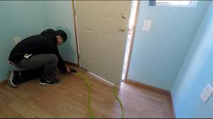 Laminate Wood Floor Buckling by How To Install Laminate Wood Flooring And Trim Work Youtube