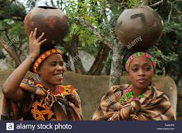 Two Zulu Maidens In Traditional Dress Balancing Clay Pots On Heads South Africa Travel Ethnicity Culture