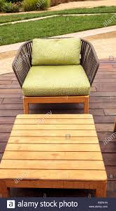 Wood Patio Lounge Chairs With Green Cushions Stock Photo: 227311441 ... Sunnydaze Decor Oversized Black Zero Gravity Sling Patio Lounge Pair Of Outdoor Chairs By Karl Lightfoot Studio For Sale At Chair Alinum Frame Durable Weather Resistant Corliving Brown Recling Walmart Canada Orbital Folding Rocking With Pillow Antique Stick Wicker 1stdibs Jens Risom Hivemoderncom Shop Christopher Knight Home Chaise Beachfront Sofa C Luxe Outside Unique Wooden Aed4012 Mainland Mark Thomas Lakeport 3pc Adjustable Green Set