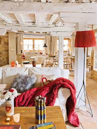 Immersed In Rustic Style The Renovated Farmhouse Retains Traditional Touches Enhanced With Colourful Decor Accessories Bold Prints And Country Chic