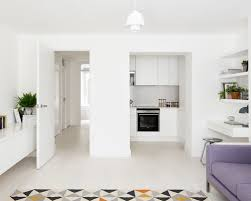 Example Of A Small Danish Open Concept Light Wood Floor Living Room Design In London With