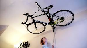 Ceiling Bike Rack Flat by Stowaway Storage System Is Designed For People Who Look Up To