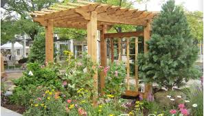 Pergola : Different Shaped Pergola Makes A Nice Backdrop For The ... Backyards Backyard Arbors Designs Arbor Design Ideas Pictures On Pergola Amazing Garden Stately Kitsch 1 Pergola With Diy Design Fabulous Build Your Own Pagoda Interior Ideas Faedaworkscom Backyard Workhappyus Best 25 Patio Roof Pinterest Simple Quality Wooden Swing Seat And Yard Wooden Marvelous Outdoor 41 Incredibly Beautiful Pergolas