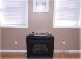 How To Put In A Gas Fireplace by Fireplace Installation Gas Vs Wood