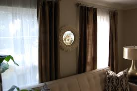 beautiful curtain designs for living room with brown furniture