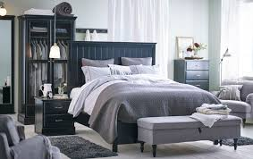 A Large Bedroom With Big Black Bed Standing In The Middle Of Room