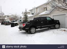 4x4 Pickup Trucks Parked In Driveway In Snow Covered Residential ...
