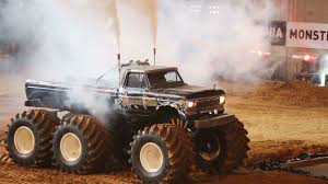 100 Big Monster Truck MOSCOW RUSSIA MARCH 23 2013 With Six Wheels