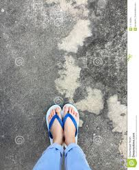 Download Blue Flip Flop On Cement FloorTop View Beautiful Woman Wearing Shoes
