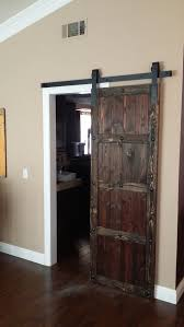 Custom Spanish Style Sliding Barn Door With Clavos Located In San Diego