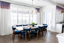Blue Dining Room With White And Purple Curtains